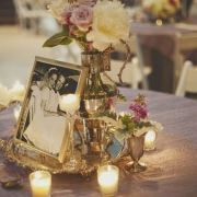 silver, votives, and family wedding photos make a beautiful simple tablescape