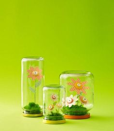 Cheery, no-maintenance button-blossom terrariums are a fun project to make for mom. #DIY