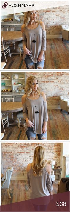 """Taupe cold shoulder 3/4 sleeve tunic Modeling size small.  80.5% rayon 19.5% cotton Bust laying flat pit to pit: S 19"""" M 20"""" L 21"""" Length S 30"""" M 31"""" L 32"""" Add to bundle to save when purchasing  IRPD7000209.P2222 Infinity Raine Tops Tunics"""