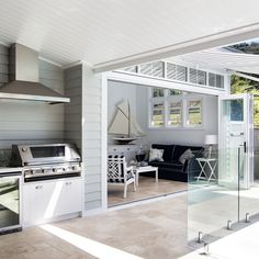 A neutral colour palette and Scyon Linea weatherboards are key for achieving a modern coastal look. Indoor Outdoor Living, Outdoor Rooms, Outdoor Areas, Hamptons House, The Hamptons, Grafton House, Weatherboard House, Built In Bbq, House Extensions