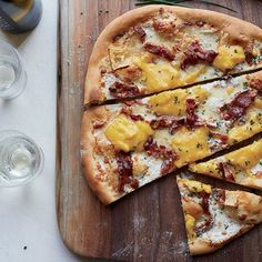 This incredible breakfast pizza features crisp bacon, scrambled eggs and both Brie and mozzarella cheeses.