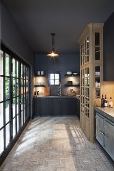 Charcoal walls, light floors & cabinet