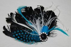 Black Turquoise blue and white Feather Boutique Hair Clip Fascinator Photp Prop. $26.99, via Etsy.