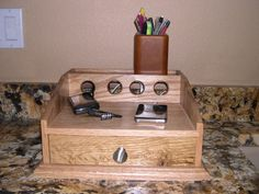 Cell Phone Charging Station- Oak. This one is the best for us; our iPhone is always in its Otterbox (Defender series + belt clip), so it won't fit in to most charging stations with dividers.