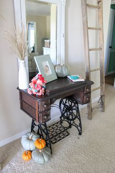 Being on a tight ($20) decorating budget didn't stop this Mom from being resourceful and using what she had and what she could find for free to bring fall decor into her home. You could do it too!