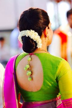 Saree or sari blouse design with tassels. Hair bun with jasmine flowers.
