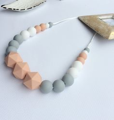 This Silicone Teething Necklace/ Nursing Mama Rocks necklaces are: great for teething babies, nursing mamas, and entertainment while babywearing. If you are doing and dealing with all three (which I bet a lot of you are) you are a rockstar! . Listing is for the color shown. You can change colors no problem! Just send me a message. You choose DIY Kit or already made necklace.  * BPA FREE, Phthalates FREE, Cadmium FREE, Lead-FREE & PVC FREE * Highest quality food-grade silicone on the market…