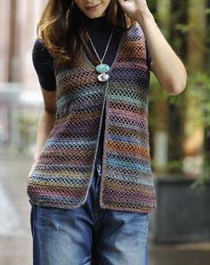 Simply crochet vest that I image with a seam up the front and turned into a comfortable tank top type shirt :)
