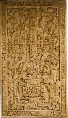 """Pakal Sarcophagus Lid, Maya Temple of the inscriptions, Palenque. « Pakal lies on top of the """"earth monster."""" Below him are the open jaws of a jaguar, symbolizing Xibalba. Above him is the Celestial Bird, perched atop the Cosmic Tree (represented by a cross) which, in turn, holds a Serpent in its branches. Thus, in the image Pakal lies between two worlds: the heavens and the underworld. » (photo by Asaf Braverman; description from wikipedia)"""