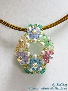 Pattern from Japanese book Beads De Beads #6, I can't read the designer's name, sorry. The finished pendant looks easy but it's definitely not. It took me two tries to get it right with lot of headache. lol