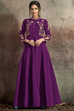 Get gorgeous in this purple art silk anarkali suit which will instantly catch your fancy. This chinese collar neck and 3/4th sleeve suit is plain. Matched with santoon churidar in purple color with purple nazneen dupatta. Churidar is plain. Dupatta is plain. #anarkalisuit #usa #Indianwear #Indiandresses #andaazfashion Indian Party Wear Gowns, Party Wear Gowns Online, Gown Dress Online, Evening Gowns Online, Designer Evening Gowns, Designer Gowns, Party Wear Dresses, Indian Dresses, Shadi Dresses