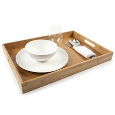 Classic Tray in Natural $47, made entirely from bamboo, one of the world's most sustainable, renewable resources, this tray will complement any décor, and the built-in handles make it easy and convenient to carry