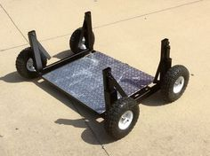 A dolly design to load things onto trailers. With steel tubing / a flat plate / added wheels and a lever system to lift the wheels from the ground - you can go a static dolly to movable dolly quickly.