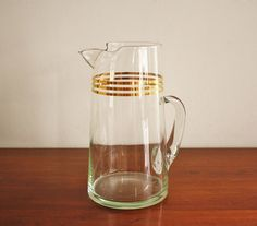 1960s glass martini pitcher with gold stripes.