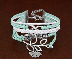 A super cute bracelet stack. A sweet bird on a branch, a pair of wise owls and an infinity sign on mint cording with a white vegan leather braid.