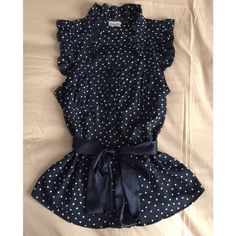"""Pretty Black Top with pattern and ruffle Never worn. Black with """"polka squares"""" all over. Buttons up and has a silky material wrap around. Fitted top. Tops Blouses"""