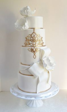Spectacular gold  Wedding Cakefrom Talented The Cake Whisperer. To see more: http://www.modwedding.com/2014/01/24/35-spectacular-wedding-cakes/