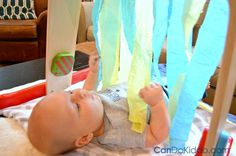 Simple play for newborn babies : make a streamer curtain. CanDo Kiddo