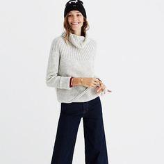 Our take on a timeless ski sweater, this supersoft turtleneck has a cool circular ribbed yoke and a playful pom-pom drawstring at the hem. There's a definite sitting-fireside-at-the-chalet vibe, we think. <ul><li>Acrylic/nylon/wool/mohair.</li><li>Hand wash.</li><li>Import.</li></ul>