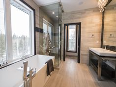 Talk about a relaxing view - soaking in this tub while overlooking the trees! Photo by Digital Video Listings.