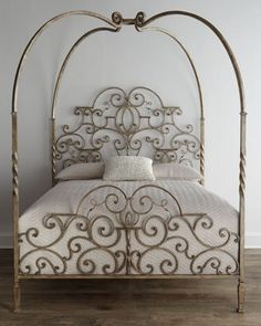 Wrought iron canopy bed.