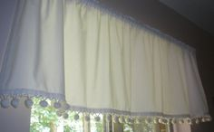 I had a piece of vintage cotton fabric and some excellent vintage cotton pompoms ~ sewed them together for adorable valances. They are made of
