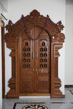 Love love love the door. This is the door I am looking for. Love the sculpture and workmanship and e color of wood puja room design. home mandir. Decor Wedding, Wedding Colors, Wedding Flowers, Space Wedding, Temple Design For Home, Wooden Main Door Design, Mandir Design, Pooja Room Door Design, Design Bedroom