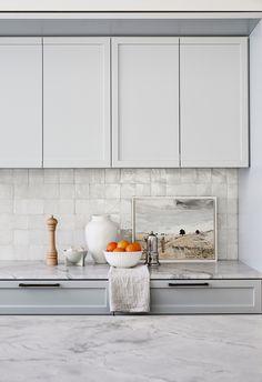 Soft light blue grey with pearl splashback tiles in kitchen.