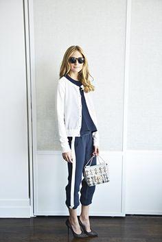 Olivia in Dior sunglasses, a Chloe bag, Joseph pants, Aquazurra shoes, a CH Carolina Herrera top and a Sandro sweater.