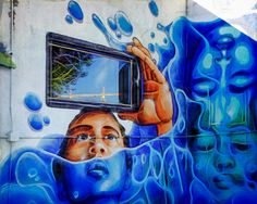 "Window To The World - Graffiti art incorporating building elements.  In this case, the ""camera phone"" is a window ... cool. #graffiti #wallart #wynwood #miami #blue #window #outdoors"