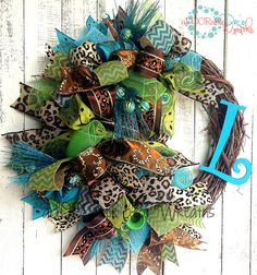 Peacock and Leopard Initial Wreath For more aDOORable Deco Wreaths check out www.facebook.com/ADOORableDecoWreaths or www.aDOORableDecoWreaths.etsy.com