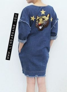 Loose fit denim dress with embroidery patches at back