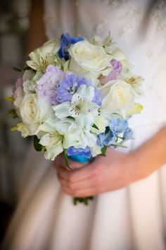 White roses and alstroemeria, blue delphinium and lavender lisianthus.