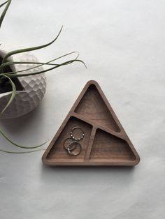 Tri-Bowl ~ Our small triangle dish is carved from one piece of solid walnut hardwood with beautiful walnut tones. The three sections are nicely sized for a jewelry tray, ring dish, mens rings and cufflinks, change, or small office supplies like paper clips and push pins. Adds a touch of minimalist modern beauty to any dresser top or desk top. Tri-bowl: solid walnut || approx 5.5 wide x 7/8 tall || untreated for a modern rustic matte finish  +Made in Chicago+  Ships First Class USPS - Pri...