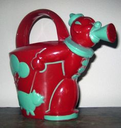 I have seen this charming plastic watering can being attributed to Rosbro Plastics but there are no markings so� I cannot be certain. Say circa, 1950s. It is, for sure, adorable!Bright red with turquo