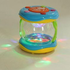 Children's Mini Magic Hand Drum with LED and Music Educational Rattle