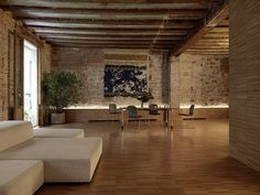 Bench with light behind using a brick wall.  Crusch Alba by Gus Wüstemann Architects. Beautiful warehouse features.
