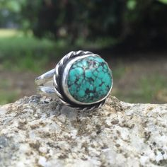 Turquoise Ring, Size 5 1/4, Sterling Silver  This striking teal turquoise stone with black webbing is wrapped in hand-twisted rope and sits atop a hand-formed & split, double ring shank. Ring details: Size- 5 1/4 Dimension of ring top- 1/2 x 5/8 x 1/4 (approx) Weight- 6 grams Shank width (width of band from base of finger to knuckle)- 1/4 Zodiac Birthstone: Sagittarius (22 Nov - 21 Dec) Chakra Associations: Throat Energies: Traveling, Leadership, Strengthening  CHOOSE USPS PRIORITY MAIL FOR…