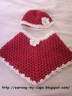 poncho and hat with flower