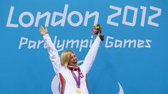 Gold medallist Joanna Mendak of Poland poses on the podium during the VictoryCeremony for the Women's 100m Butterfly - S12 final on Day 4 of the London 2012 Paralympic Games at Aquatics Centre