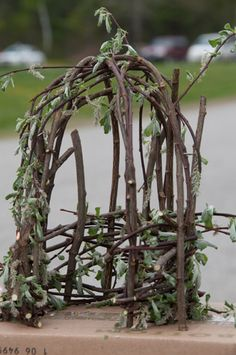 Twig fairy house Model  Teacher and students build full-size twig house.