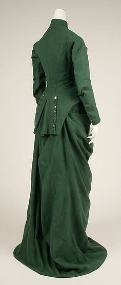 1875  Riding Habit, American.  Back Waist View.  Green wool with looped up skirt train and front buttoned jacket.  metmuseum.org     suzilove.com