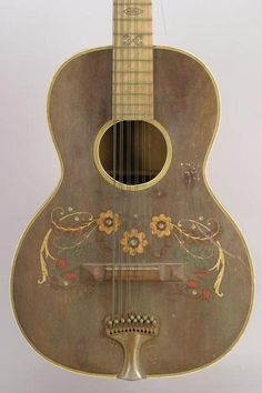 If I ever find a broken guitar--or even one that works--I think it'd be so fun to decorate and hang up real pretty like this.
