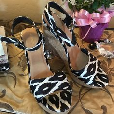 "Foschini Brand New With Tags Zebra Silk Sandals Foschini NWT Stunning Silk Zebra Sandals!  Gorgeous Black & White Fabric with a padded Footbed!  4.5"" Comfortable Wedge heel Sold for $ 380 Foschino Shoes Sandals"