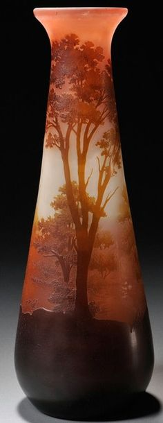 A Galle Cameo glass vase, France flared rim on cameo decorated body in earth tone landscape scene, with trees, signed, circa 1901-1925