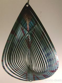 """Iron Stop Teardrop Primary colors: Blue & Purple (colors change in light as it spins) Wind Spinner 12"""" Tall x 8"""" Wide x 1-1/2"""" Deep #IronStop"""