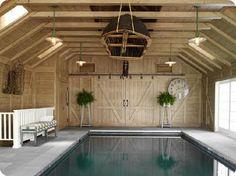 the perfect indoor pool! barn doors & canoe overhead