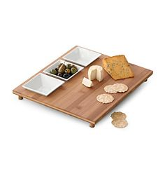 LivingQuarters appetizer and cheese board: Around the holidays, it often feels like you never have enough serveware. With all the cookies, dips, chips and cheeses to share you can run out of dishes pretty quickly. Help your host out and gift him a practical but stylish gift like this cheese board. This one has the added bonus of accompanying dishes perfect for olives, spreads and more.