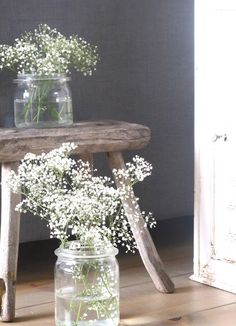 mason jar filled with baby's breath for cake or guest book table