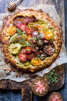 Heirloom Tomato and Zucchini Galette with Honey + Thyme - A beautiful medley of summer veggies, all tucked into one yummy galette- From halfbakedharvest.com
